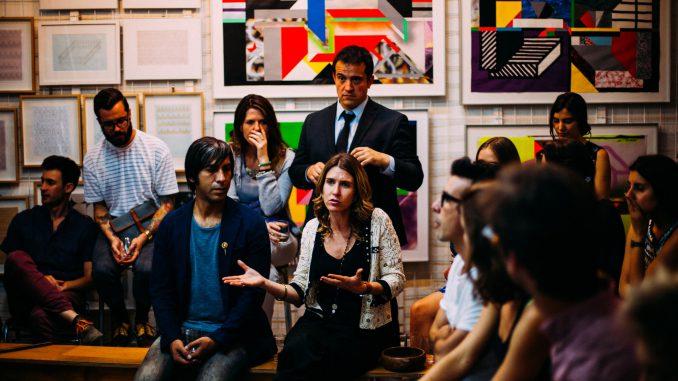 People meeting in a room, looking serious