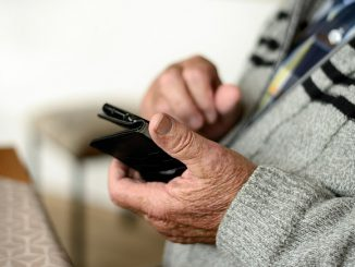 older person holding mobile phone