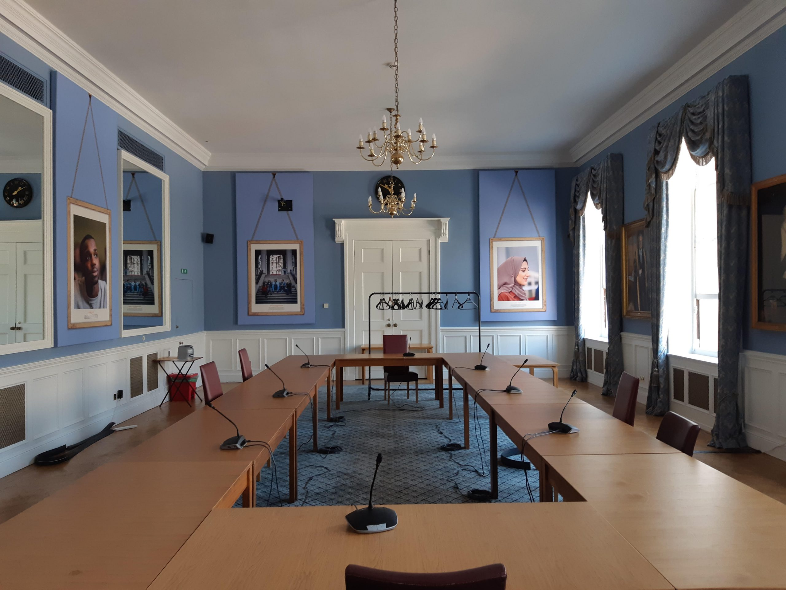 Image of the council room set up for a committee meeting.