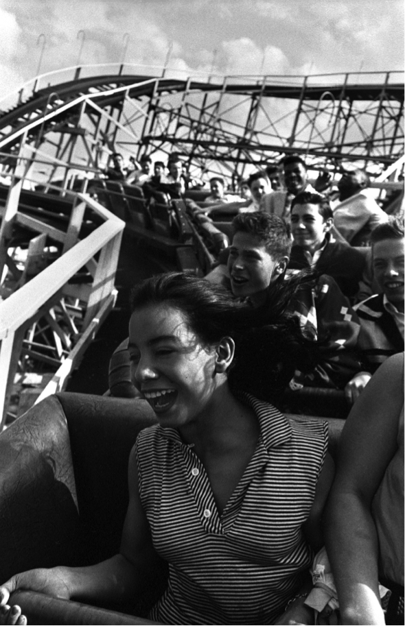 A black and white still of a woman on a rollercoaster