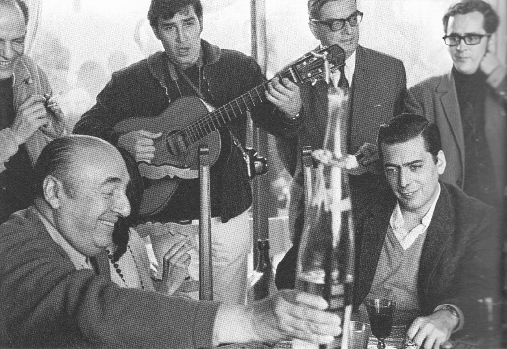 Figure 1: Pablo Neruda, Mario Vargas Llosa (seated), with Roger Caillois and Angel Rama (standing on the right), at a literary meeting at Vina de Mar (1969)