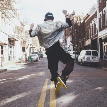happy person dancing on the street