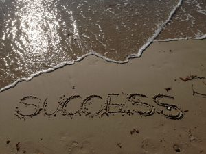 """The word """"success"""" written on the sand"""