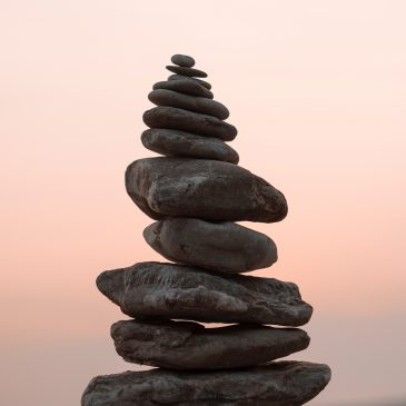 A close up photograph of rocks balanced on top of each other