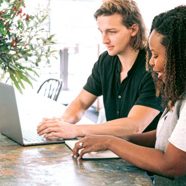 Man and woman working together on a laptop