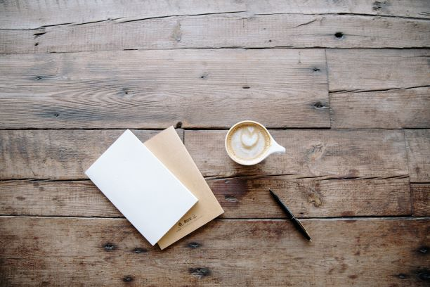 image of coffee cup and notebook