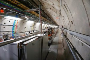 Hadron Collider at CERN looking like a grey tunnel with coloured wires throughout