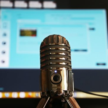 Image of mic in front of a laptop