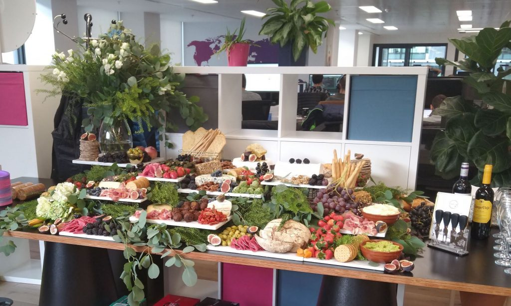 fruits, vegetables and sweet treats laid on a table to present