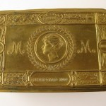 Brass tobacco tin sent to all service personnel on the Western Front and in the Navy by the Princess Mary Christmas fund, December 1914
