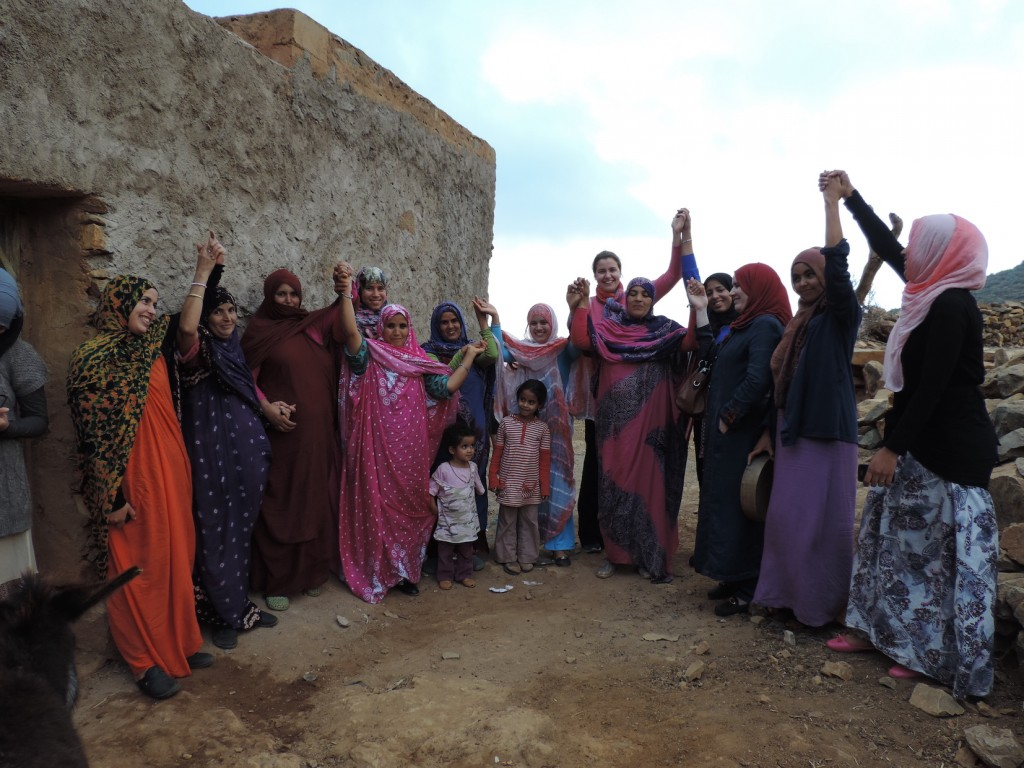 PhD researcher Becca Farnum celebrates with women in Dar Si Hmad's fog villages